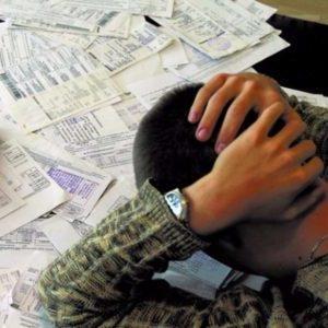 Как продать неприватизированную квартиру с долгами?